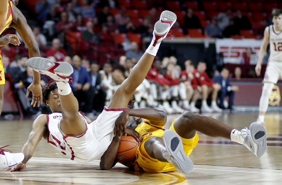 Photo - Oklahoma's Alondes Williams (15) collides with Iowa State's Solomon Young (33) during an NCAA basketball game between the University of Oklahoma Sooners (OU) and the Iowa State Cyclones at the Lloyd Noble Center in Norman, Okla., Wednesday, Feb. 12, 2020. [Bryan Terry/The Oklahoman]