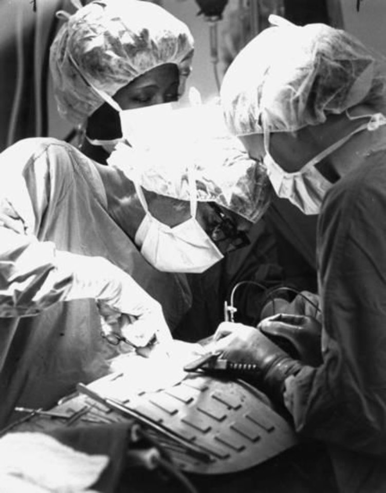 Photo -  Dr. Nazih Zuhdi, Oklahoma City heart surgeon, performs Oklahoma's first heart transplant in 1985. [Photo provided]