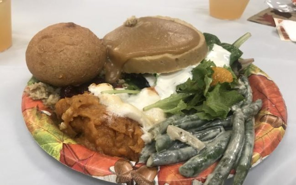 Photo -  A plate of food awaits guests at the Community Plant-based Thanksgiving Dinner hosted by A Table In The Wilderness. [Carla Hinton/The Oklahoman]
