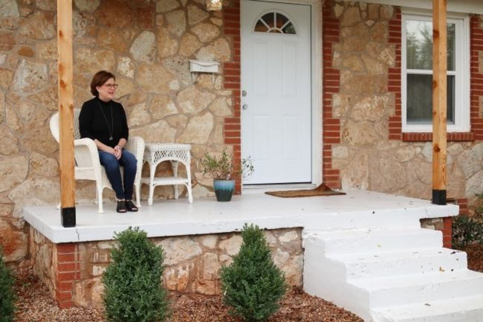 Photo -  Rhonda Hefton, a founding board member of HopeHouse OKC, sits on the porch of Hannah's House,  an Oklahoma City home recently renovated to provide housing for pregnant participants of the ReMerge program. [Doug Hoke/The Oklahoman]