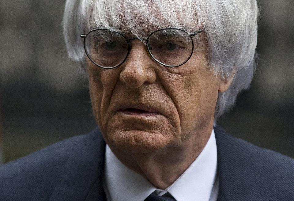 Photo - FILE - In this Nov. 11, 2013 file picture President and CEO of Formula One Management Bernie Ecclestone arrives for his case at the High Court in London. Ecclestone goes on trial in Munich on Thursday, April 24, 2014, on bribery charges that could put him in prison for up to 10 years if convicted. The trial could spell the end of the 83-year-old Ecclestone's career in the racing series that has become a lucrative business under his guidance. (AP Photo/Matt Dunham, File)
