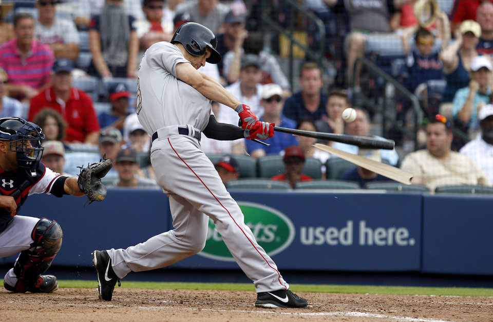 Photo - Boston Red Sox's Grady Sizemore (38) breaks his bat as he hits during the seventh inning of a baseball game against the Atlanta Braves on Monday, May 26, 2014, in Atlanta, Ga. (AP Photo/Butch Dill)