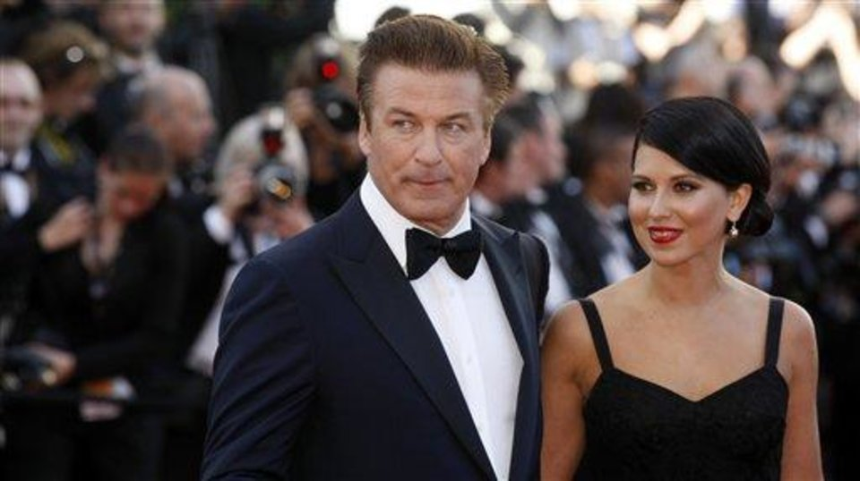 Photo - Actor Alec Baldwin, left, and Hilaria Thomas arrive for the opening ceremony and screening of Moonrise Kingdom at the 65th international film festival, in Cannes, southern France, Wednesday, May 16, 2012. (AP Photo/Lionel Cironneau)