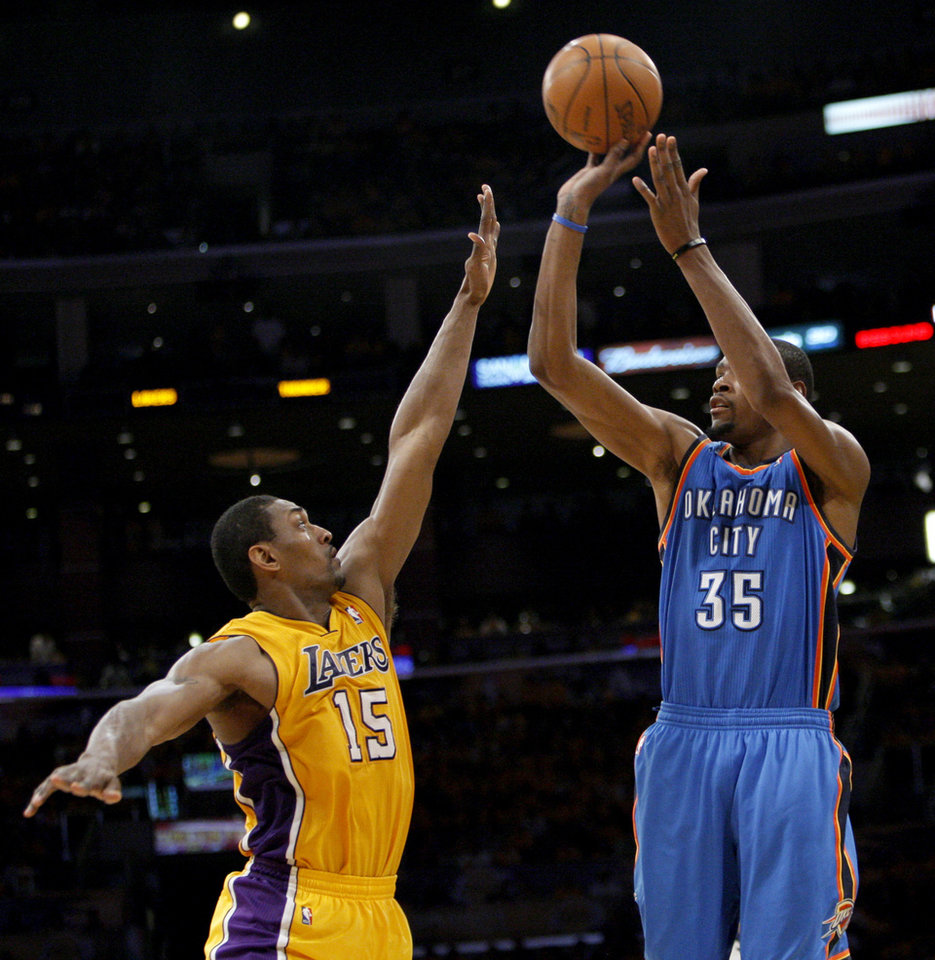 Oklahoma City's Kevin Durant (35) shoots over Los Angeles' Metta World Peace (15) during Game 3 in the second round of the NBA basketball playoffs between the L.A. Lakers and the Oklahoma City Thunder at the Staples Center in Los Angeles, Friday, May 18, 2012. Photo by Nate Billings, The Oklahoman