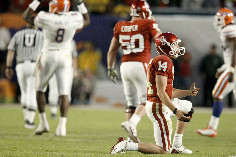 Photo - OU's Sam Bradford reacts after throwing an interception during the second half of the BCS National Championship college football game between the University of Oklahoma Sooners (OU) and the University of Florida Gators (UF) on Thursday, Jan. 8, 2009, at Dolphin Stadium in Miami Gardens, Fla. PHOTO BY BRYAN TERRY, THE OKLAHOMAN