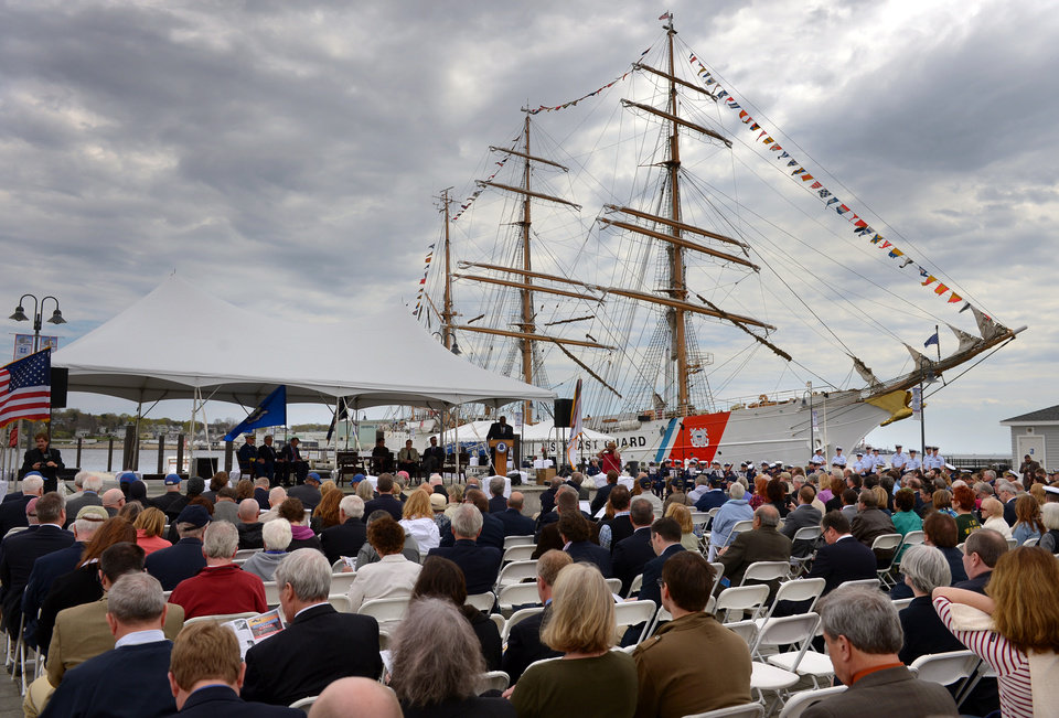 Photo - A crowd gathers in the shadow of the United States Coast Guard Barque Eagle for the transferal of the deed and ground breaking ceremonies for the National Coast Guard Museum at the City Pier Stage on Waterfront Park in New London, Conn., Friday May 2, 2014. (AP Photo/The Day, Tim Cook)