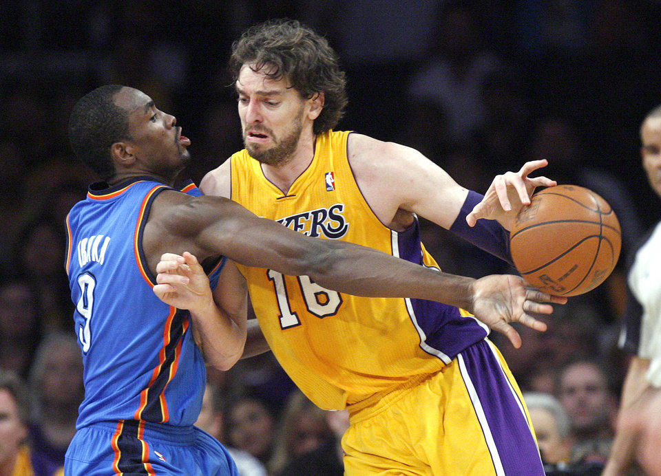 Oklahoma City's Serge Ibaka (9) defends against Los Angeles' Pau Gasol (16) during Game 4 in the second round of the NBA basketball playoffs between the L.A. Lakers and the Oklahoma City Thunder at the Staples Center in Los Angeles, Saturday, May 19, 2012. Photo by Nate Billings, The Oklahoman