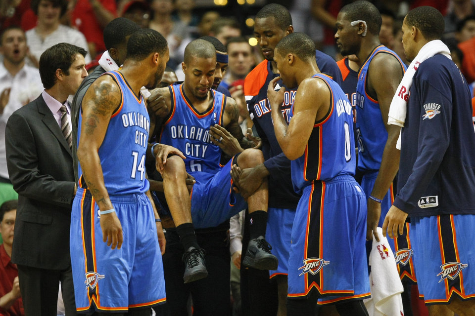 Oklahoma City Thunder point guard Eric Maynor (6) is carried off the court after twisting his knee in the Houston Rockets vs. Oklahoma City Thunder NBA basketball game at the Toyota Center, Saturday, Jan. 7, 2012, in Houston. The Oklahoma City Thunder went on to win 98-95. ( Michael Paulsen / Houston Chronicle ) ORG XMIT: 430459