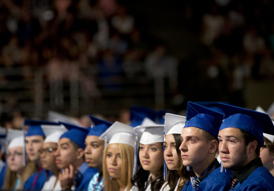 Photo - Members of the class of 2014 listen to President Barack Obama deliver the commencement address for Worcester Technical High School, Wednesday, June 11, 2014, in Worcester, Mass. (AP Photo/Pablo Martinez Monsivais)