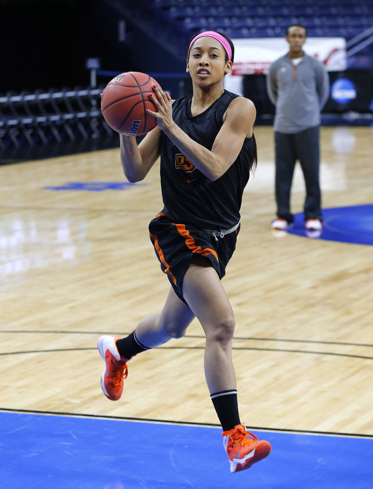 Photo - Oklahoma State guard Tiffany Bias drives during an NCAA women's college basketball tournament practice at the Purcell Pavilion in South Bend, Ind., Friday, March 28, 2014. Oklahoma State plays Notre Dame on Saturday. (AP Photo/Paul Sancya)