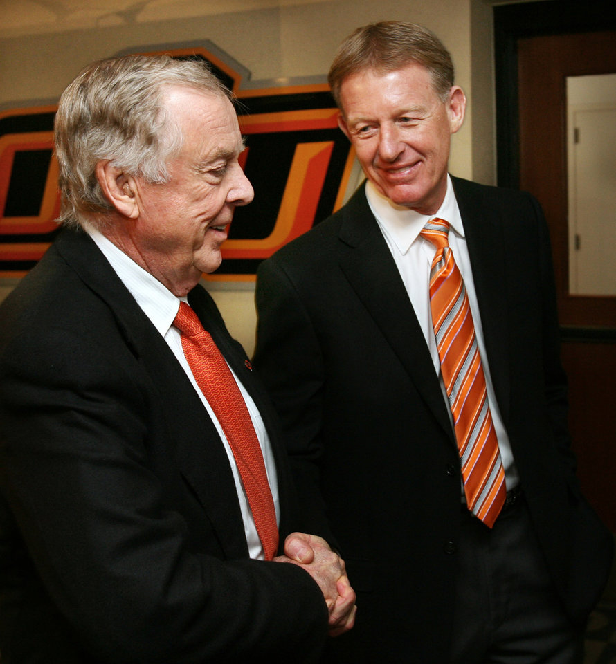 Boone Pickens (left) is congratulated by athletic director Mike Holder after the announcement of Picken's gift of $165 million to Oklahoma State University's athletic department in Stillwater, Oklahoma on Tuesday, January 10, 2006.  PHOTO BY STEVE SISNEY, The Oklahoman