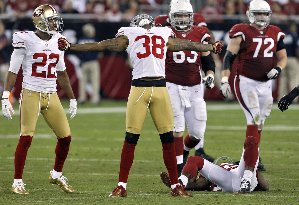 Photo -   San Francisco 49ers free safety Dashon Goldson (38) celebrates his hit on Arizona Cardinals wide receiver Andre Roberts during the second half of an NFL football game, Monday, Oct. 29, 2012, in Glendale, Ariz. The 49ers won 24-3. (AP Photo/Ross D. Franklin)