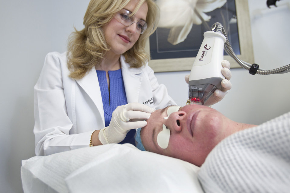 Photo - Dr. Leyda E. Bowens performs a Fraxel Laser treatment for wrinkles. (C.W. Griffin/Miami Herald/MCT)