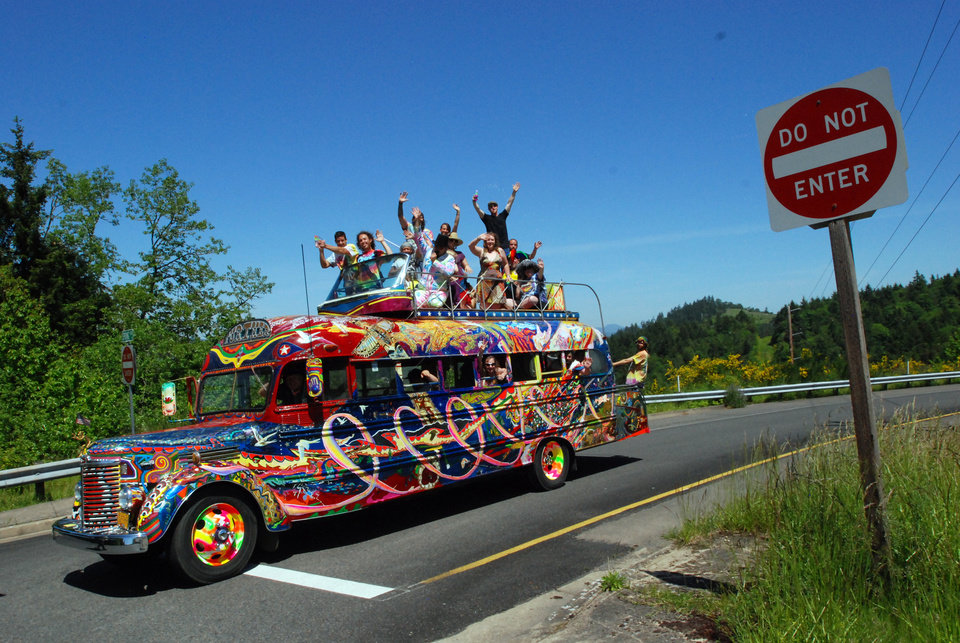 Photo - In a May 14, 2014 photo, the reincarnation of author Ken Kesey's psychedelic bus Further stops along a road in Eugene, Ore. Zane Kesey, son of the late author, is on Kickstarter raising money for a cross-country trip commemorating the 1964 LSD-fueled bus trip that became a touchstone of the 1960s. The orginal bus is not road-wrothy, but this newer version bought by Ken Kesey to keep the spirit of the bus alive is still rolling, though in need of repairs. (AP Photo/Jeff Barnard)
