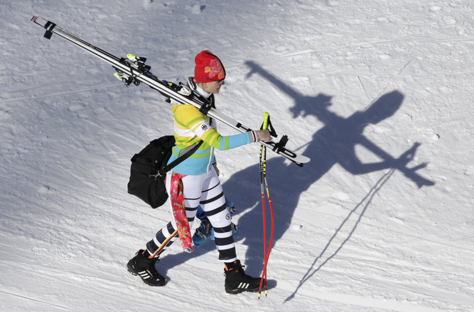 Photo - Germany's Maria Hoefl-Riesch walks away from the finish area following a women's downhill training run for the Sochi 2014 Winter Olympics, Friday, Feb. 7, 2014, in Krasnaya Polyana, Russia. (AP Photo/Gero Breloer)