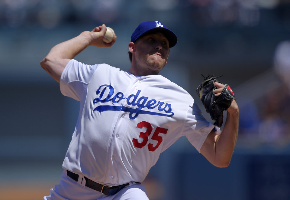 Photo - Los Angeles Dodgers starting pitcher Kevin Correia throws to the plate during the first inning of a baseball game against the New York Mets, Sunday, Aug. 24, 2014, in Los Angeles. (AP Photo/Mark J. Terrill)