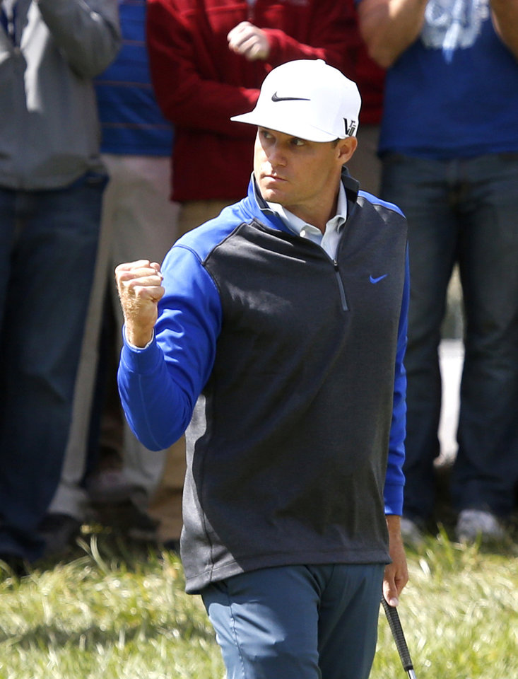 Photo - Nick Watney pumps his fist after making a birdie on the 17th green during the final round of the BMW Championship golf tournament at Conway Farms Golf Club, Monday, Sept. 16, 2013, in Lake Forest, Ill. (AP Photo/Charles Rex Arbogast)