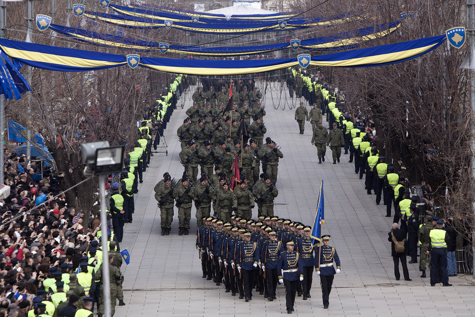 Photo - Kosovo Security Force honor guard leads the parade in the center of Pristina marking the 5th anniversary since Kosovo seceded from Serbia on Sunday, Feb. 17, 2013. Serbia rejects Kosovo's independence. (AP Photo/Visar Kryeziu)