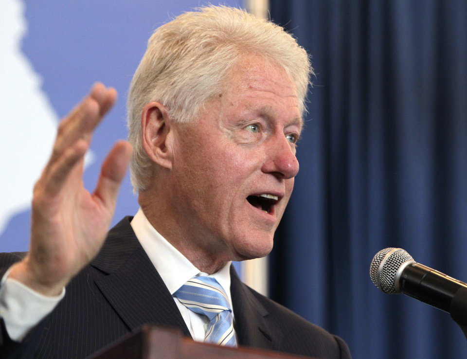 Photo - Former President Bill Clinton speaks during a political event for Alison Lundergan Grimes at the Carrick House in Lexington, Ky., on Wednesday, Aug. 6, 2014. Grimes is the Democratic challenger to Sen. Mitch McConnell.  (AP Photo/The Herald-Leader, Pablo Alcala)
