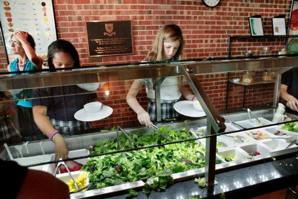 Photo - Students load their plates at the salad bar now offered every lunch at Casady School as part of a new dinning plan that emphasizes students making healthier decisions. Photo by Jim Beckel, The Oklahoman  JIM BECKEL - THE OKLAHOMAN