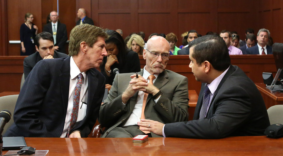 Photo - George Zimmerman, right, talks with his defense counsel, Mark O'Mara, left, and Don West, after Judge Debra Nelson informed them that the jury had a questions, on the 25th day of Zimmerman's trial at the Seminole County Criminal Justice Center in Sanford, Fla., Saturday, July  13, 2013. Zimmerman is charged with second-degree murder for the 2012 shooting death of Trayvon Martin.(AP Photo/Joe Burbank, Pool) ORG XMIT: FLJR223