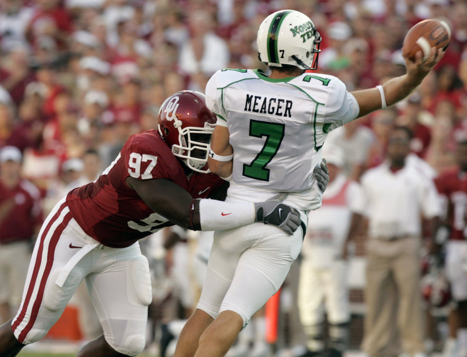 Photo - Oklahoma's Cory Bennett (97) hits North Texas quarterback Daniel Meager (7) as he throws the ball in the first half during the University of Oklahoma Sooners (OU) college football game against the University of North Texas Mean Green (UNT) at the Gaylord Family - Oklahoma Memorial Stadium, on Saturday, Sept. 1, 2007, in Norman, Okla.