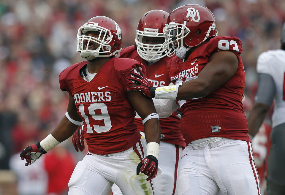 Oklahoma's Eric Striker (19) celebrates after a sack beside Oklahoma's Jordan Wade (93) during a college football game between the University of Oklahoma Sooners (OU) and the Texas Tech Red Raiders at Gaylord Family-Oklahoma Memorial Stadium in Norman, Okla., on Saturday, Oct. 26, 2013. Oklahoma won 38-30. Photo by Bryan Terry, The Oklahoman