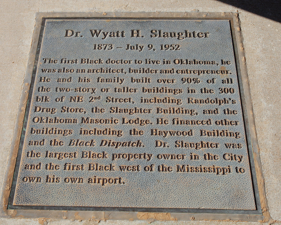 Photo - This bronze plaque commemorating Dr. Wyatt H. Slaughter can be found in Deep Deuce on the northeast corner of NE 2 and Walnut Avenue.  PAUL B. SOUTHERLAND - The Oklahoman