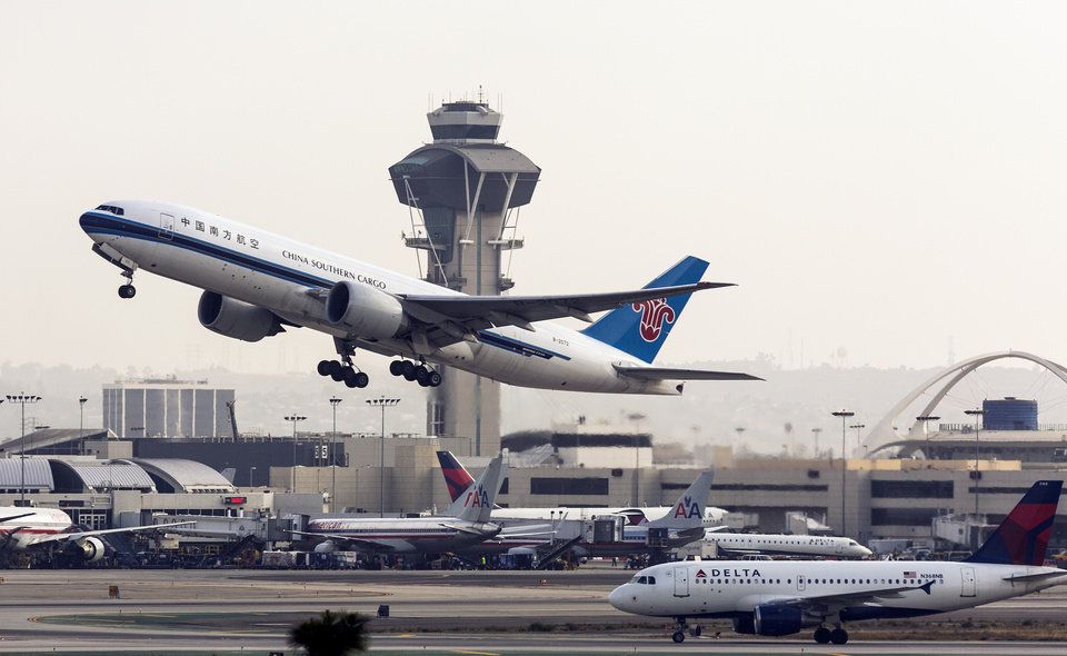 Photo - A China Southern Cargo jet takes off at LAX International airport in Los Angeles Monday, April 22, 2013. Some fliers headed to Los Angeles International Airport were met with delays yesterday on the first day of staffing cuts for air traffic controllers because of government spending reductions. Budget cuts that kicked in last month forced the FAA to give controllers extra days off. (AP Photo/Damian Dovarganes)