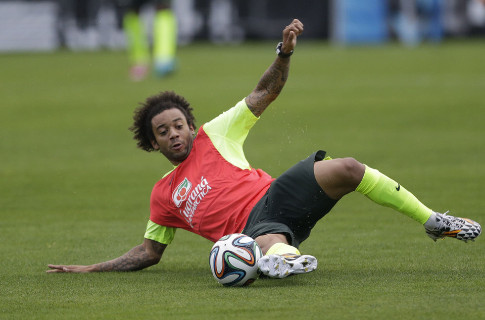 Photo - Brazil's Marcelo practices during a training session at the Granja Comary training center in Teresopolis, Brazil, Friday, June 20, 2014. Brazil plays in group A of the 2014 soccer World Cup. (AP Photo/Andre Penner)