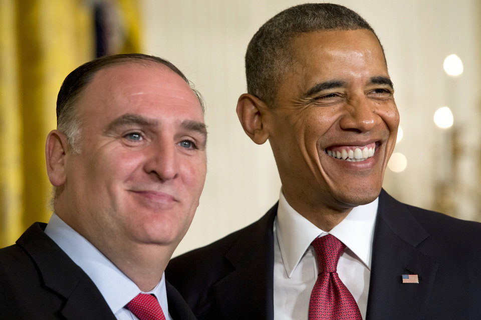 Photo - President Barack Obama smiles with chef Jose Andres, after awarding the chef with a