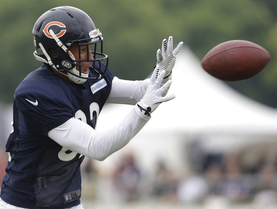 Photo - Chicago Bears wide receiver Brittan Golden (82) catches a ball during NFL football training camp Wednesday, July 31, 2013, in Bourbonnais, Ill. (AP Photo/Nam Y. Huh)