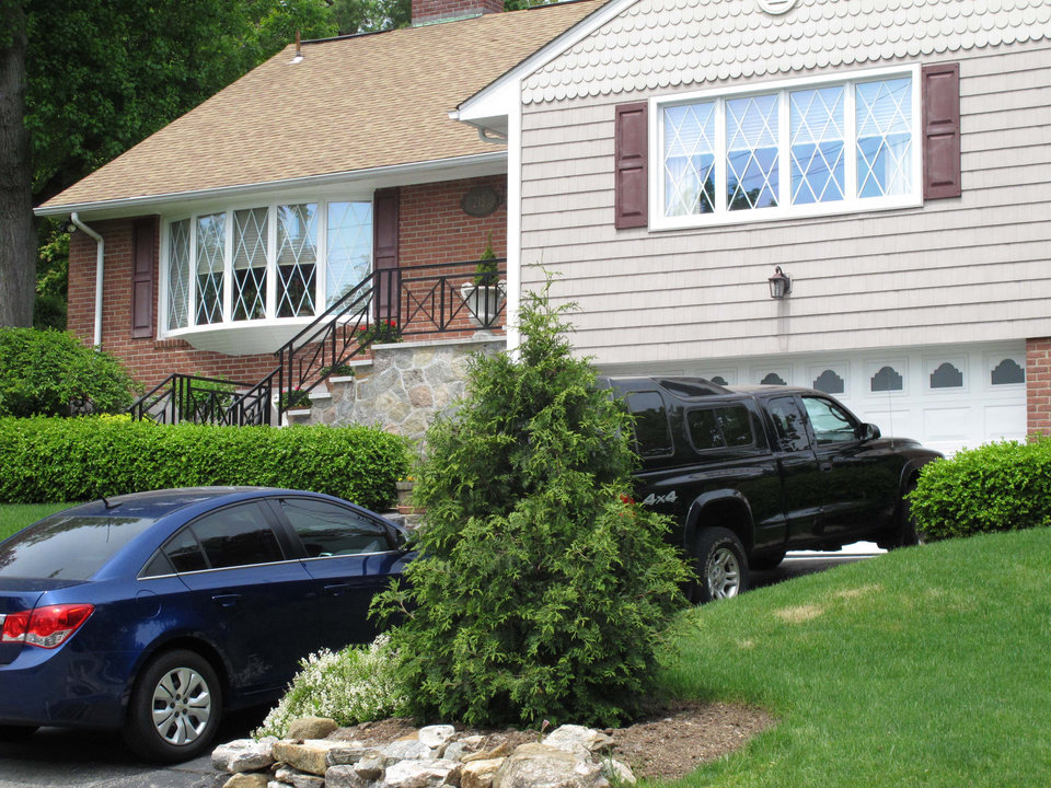 Photo - The Tarrytown, N.Y., home of the family of Hofstra University student Andrea Rubello is seen on Friday, May 17, 2013. Police say  Rubello was shot and killed Friday, May 17, 2013, during a break-in near the college campus in Uniondale, N.Y. (AP Photo/Jim Fitzgerald)