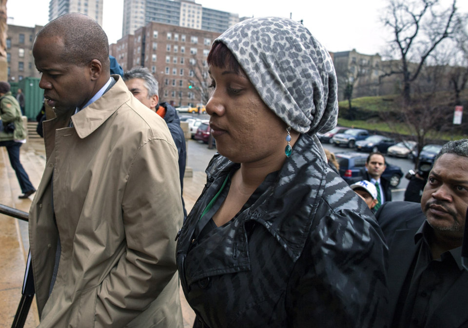 Photo - Nafissatou Diallo, who claims she was sexually assaulted by former International Monetary Fund leader Dominique Strauss-Kahn, arrives at a Bronx courthouse Monday, Dec. 10, 2012 in New York. The outcome of the sexual assault lawsuit may soon be decided in court. Lawyers for both will update a judge Monday on the status of settlement discussions.  (AP Photo/Craig Ruttle)