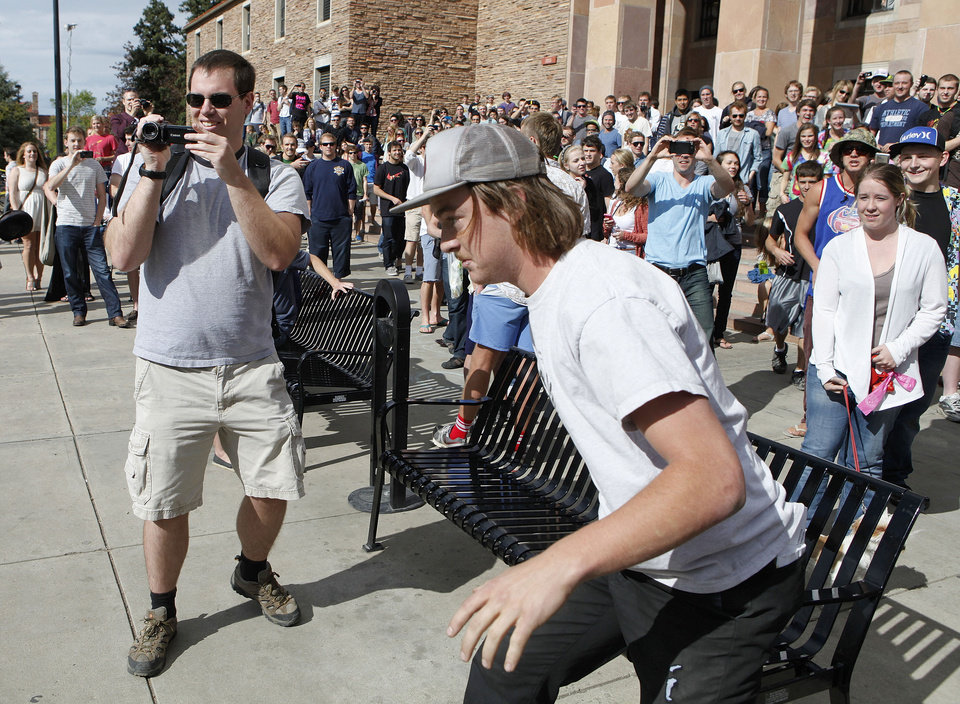 Photo -   A student runs toward the police barrier on the Norlin Quad at the University of Colorado in Boulder, Colo., on Friday, April 20, 2012, at 4:20pm. He was run down by police and arrested after crossing the barrier. Police blocked off the quad to prevent a 420 marijuana smoke out. (AP Photo/Ed Andrieski)
