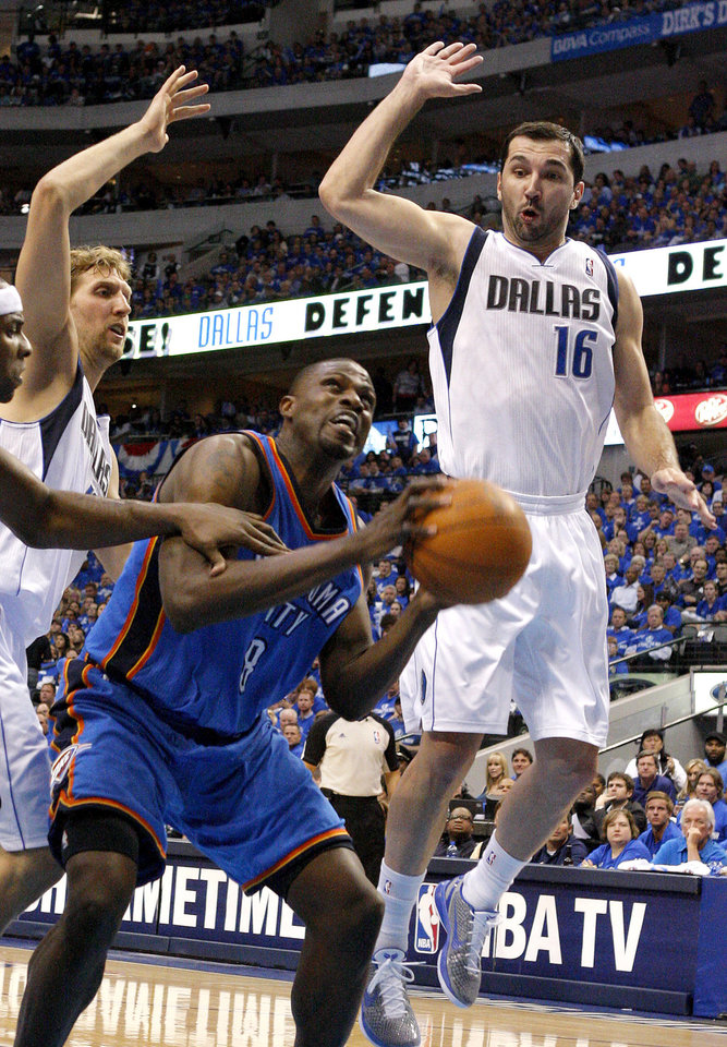 Photo - Oklahoma City's Nazr Mohammed (8) tries to go to the basket between Dirk Nowitzki (41) of Dallas  and Peja Stojakovic (16) of Dallas during game 1 of the Western Conference Finals in the NBA basketball playoffs between the Dallas Mavericks and the Oklahoma City Thunder at American Airlines Center in Dallas, Tuesday, May 17, 2011. Photo by Bryan Terry, The Oklahoman