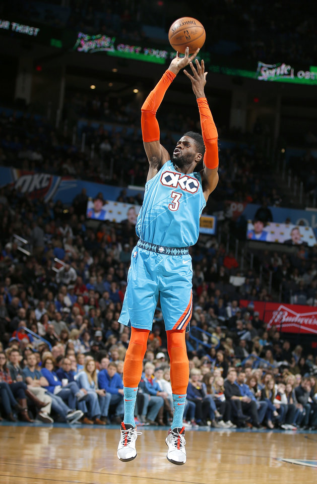 Photo - Oklahoma City's Nerlens Noel (3) shoots during the NBA basketball game between the Oklahoma City Thunder and the Memphis Grizzlies at the Chesapeake Energy Arena, Sunday, March 3, 2019. Photo by Sarah Phipps, The Oklahoman