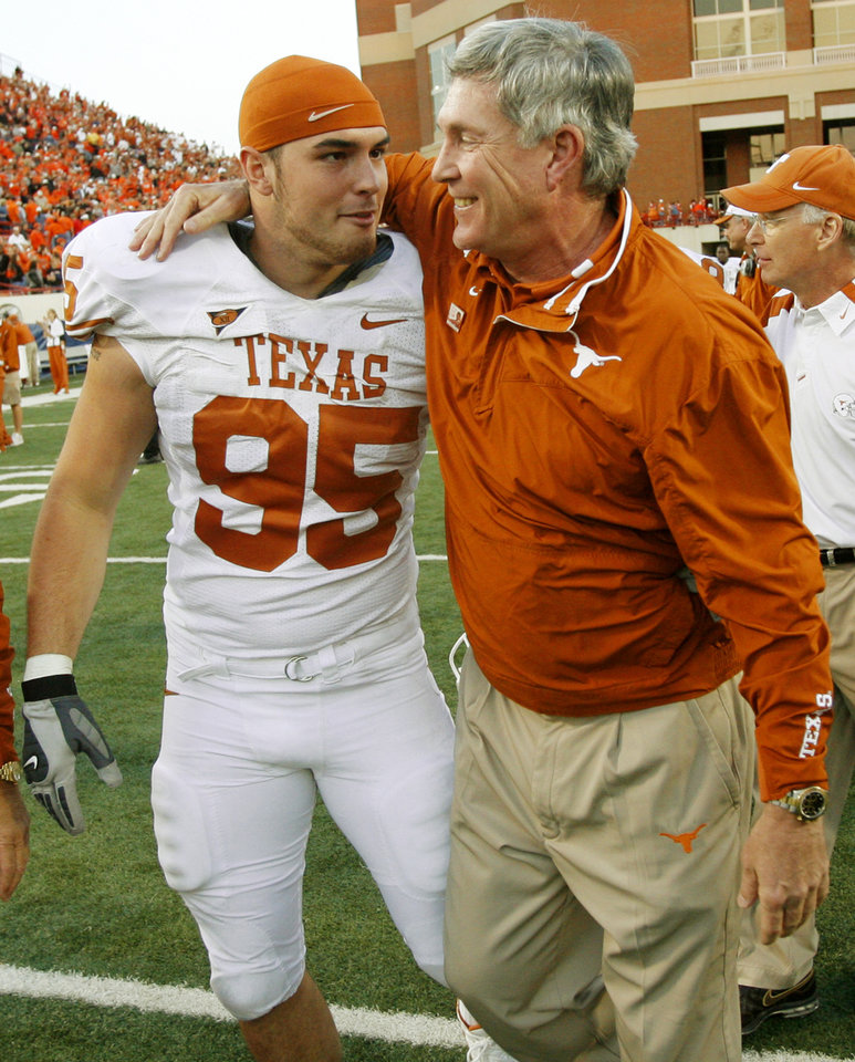 Photo - Texas head coach Mack Brown, right, celebrates with Aaron Lewis (95) after their win in the Oklahoma State University (OSU) college football game with University of Texas (UT) at Boone Pickens Stadium in Stillwater, Okla. Saturday, Nov. 3, 2007. Texas won, 38-35. BY NATE BILLINGS, THE OKLAHOMAN ORG XMIT: KOD