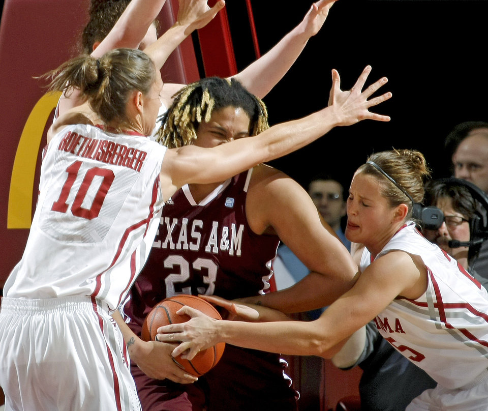 Photo - OU's Carlee Roethlisberger (10) and OU's Whitney Hand (25) try to get the ball from Texas A&M's Danielle Adams (23) during the Big 12 women's basketball game between the University of Oklahoma and Texas A&M at Lloyd Noble Center in Norman, Okla., Wednesday January 26, 2011.  Photo by Bryan Terry, The Oklahoman