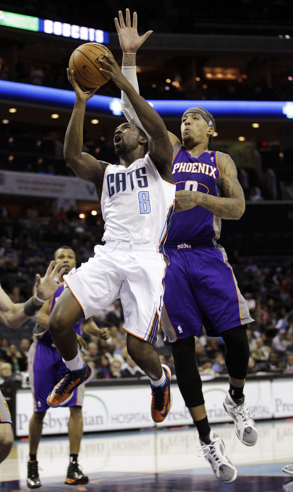 Charlotte Bobcats' Ben Gordon (8) drives past Phoenix Suns' Michael Beasley (0) during the first half of an NBA basketball game in Charlotte, N.C., Wednesday, Nov. 7, 2012. (AP Photo/Chuck Burton)