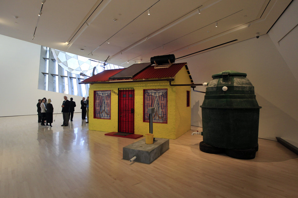 "This Nov. 9, 2012 photo ""Soweto House with Prepaid Water"" by Marjetica Potrc of Slovenia is displayed inside the Eli and Edythe Broad Art Museum on the campus of Michigan State University in East Lansing, Mich. (AP Photo/Carlos Osorio)"