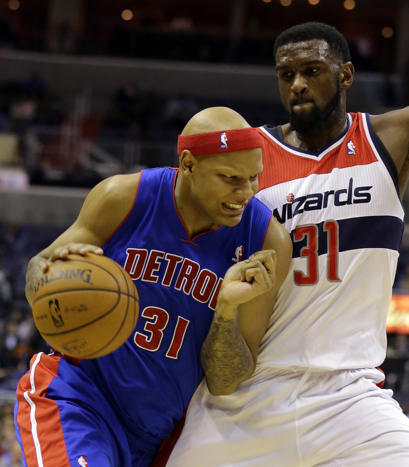 Detroit Pistons forward Charlie Villanueva drives against Washington Wizards forward Chris Singleton in the first half of an NBA basketball game on Wednesday, Feb. 27, 2013, in Washington. (AP Photo/Alex Brandon)