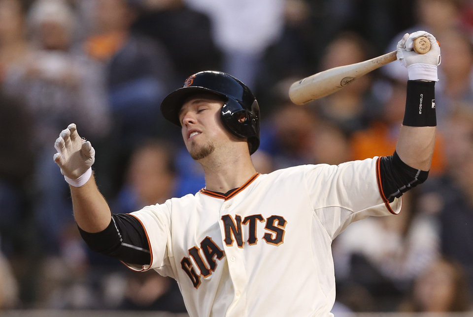Photo - San Francisco Giants' Buster Posey reacts after hitting a fly out during the third inning of a baseball game against the Washington Nationals, Monday, June 9, 2014, in San Francisco, Calif. (AP Photo/Beck Diefenbach)