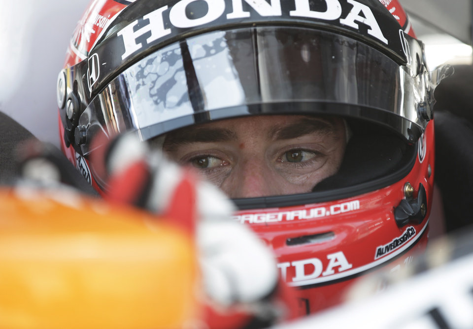 Photo - Simon Pagenaud, of France, adjust a mirror on his car during a practice session for the inaugural Grand Prix of Indianapolis IndyCar auto race at the Indianapolis Motor Speedway in Indianapolis, Thursday, May 8, 2014. (AP Photo/Darron Cummings)