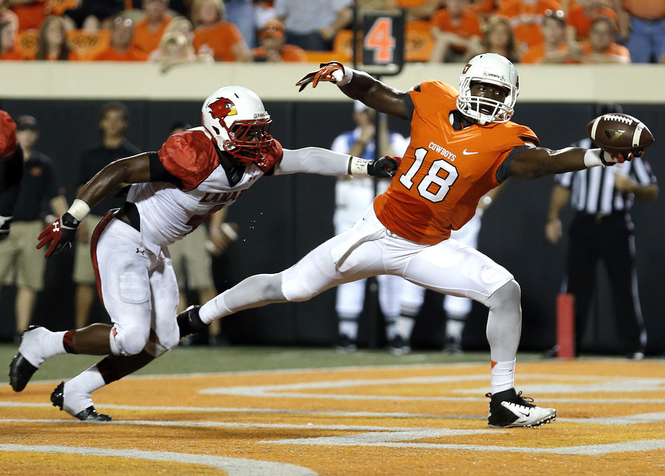 Photo - Oklahoma State's Blake Jackson (18) makes a one-handed touchdown catch in the third quarter during a college football game between the Oklahoma State University Cowboys (OSU) and the Lamar University Cardinals at Boone Pickens Stadium in Stillwater, Okla., Saturday, Sept. 14, 2013. Photo by Sarah Phipps, The Oklahoman