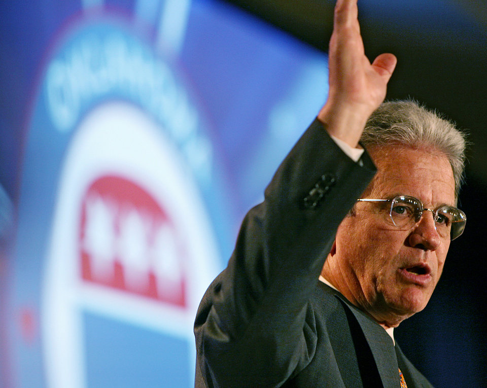 Photo - Sen. James Coburn waves to supporters after a speech during the Republican Watch Party at the Marriott in Oklahoma City on Tuesday, Nov. 2, 2010.Photo by John Clanton, The Oklahoman