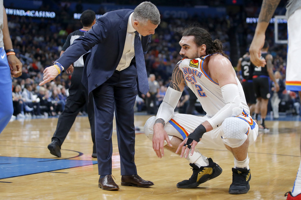 Photo - Oklahoma City coach Billy Donovan talks with Steven Adams (12) during timeout in an NBA basketball game between the Oklahoma City Thunder and the Los Angeles Clippers at Chesapeake Energy Arena in Oklahoma City, Tuesday, March 3, 2020. [Bryan Terry/The Oklahoman]
