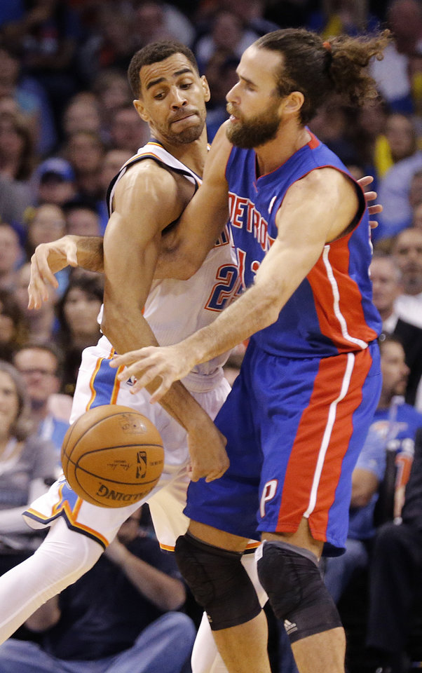 Photo - Oklahoma City's Thabo Sefolosha (25) defends on Detroit's Luigi Datome (13) during the NBA basketball game between the Oklahoma City Thuder and the Detroit Pistons at Chesapeake Energy Arena in Oklahoma City, Okla. on Wednesday, April 16, 2014.  Photo by Chris Landsberger, The Oklahoman