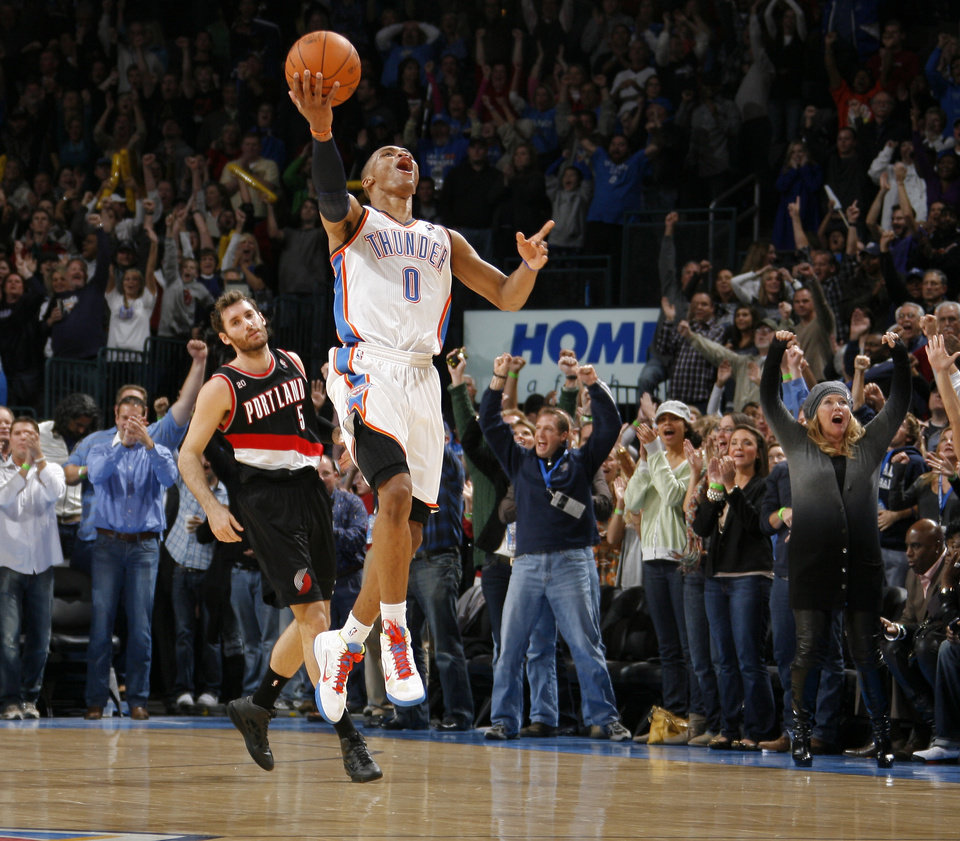 Photo - Oklahoma City's Russell Westbrook celebrates in front of Portland's Rudy Fernandez as Oklahoma City wins the NBA basketball game between the Oklahoma City Thunder and the Portland Trail Blazers at the Oklahoma City Arena on Friday, Nov. 12, 2010.   Photo by Bryan Terry, The Oklahoman