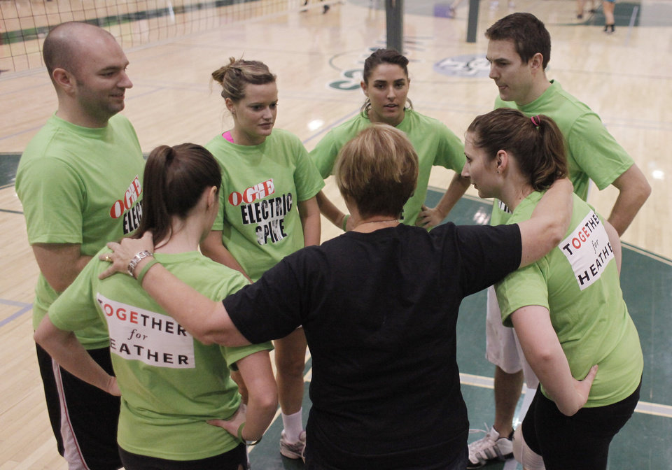 Team Electric Spike, sponsored by OG&E, huddle after a game during the Heather Harkness Memorial Volleyball Tournament at Santa Fe High School in Edmond Saturday, November 12, 2011. Photo by Doug Hoke, The Oklahoman